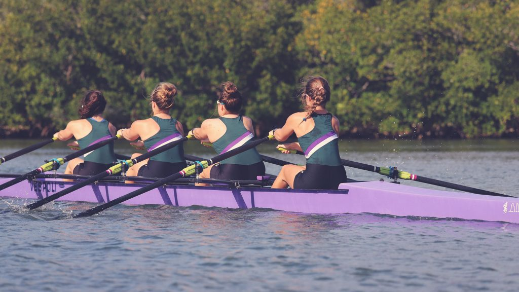 Womans quad taken from near the bow with rowers at the catch