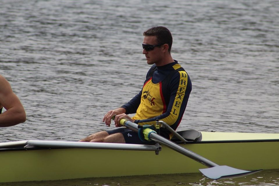 Alumni Chris Cail as bow rower